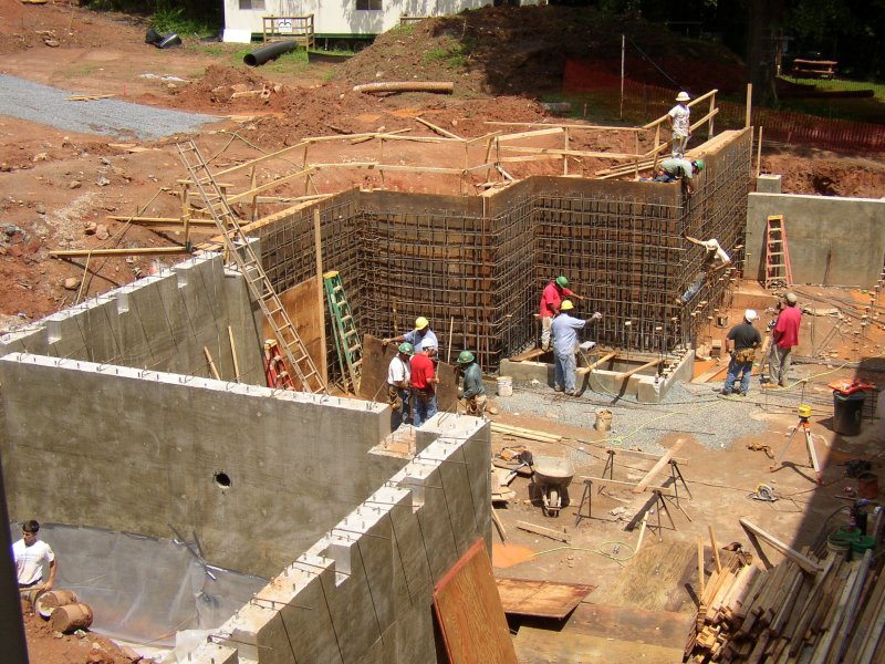 Stone hall addition for Basement foundations construction